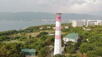 Flying around the lighthouse on the seashore Aerial shot video
