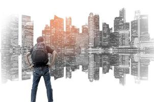Double exposure of backpacker with the cityscape background photo