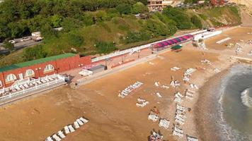 Aerial shot of the shore with white loungers video