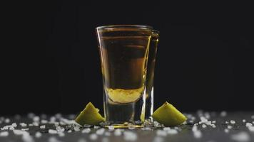 Two shot of gold tequila with lime video
