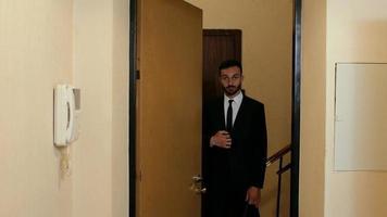 guy with a beard standing in the door video