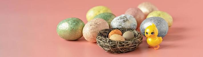Easter eggs in a natural nest with bird eggs photo