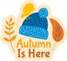 Autumn is here. Cute badge with knitted hat vector