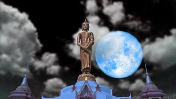 Full blue moon and Buddha on the night sky video