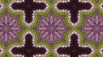 Caleidoscopio de tres colores verde y rosa. video