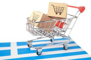 Box with shopping cart logo and Greece flag, Import Export Shopping online or eCommerce finance delivery service store product shipping, trade, supplier concept. flag, Import Export Shopping online or eCommerce finance delivery service store product shipp photo