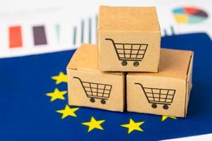 Box with shopping cart logo and EU flag, Import Export Shopping online or eCommerce finance delivery service store product shipping, trade, supplier concept. photo