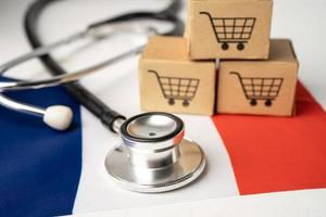 Shopping cart logo with France flag, Shopping online Import Export eCommerce finance business concept. photo