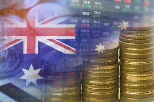 Stock market investment trading financial with coin and Australia flag, finance business concept. photo