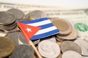 Stack of coins with Cuba flag on white background. photo