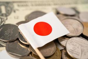 Stack of coins with Japan flag on white background. photo
