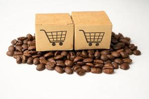 Box with shopping cart logo symbol on coffee beans, Import Export Shopping online or eCommerce delivery service store product shipping, trade, supplier concept. photo