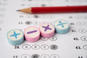 Math symbol and pencil on Answer sheet background Education study mathematics learning teach concept. photo
