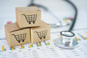 Stethoscope and shopping cart logo on box with graph background. Banking Account, Investment Analytic research data economy, trading, Business import export transportation online company concept. photo