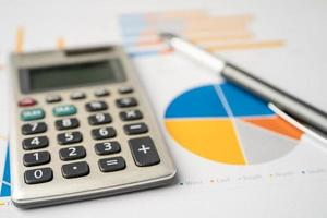 Calculator on chart and graph paper. Finance development, Banking Account, Statistics, Investment Analytic research data economy, Stock exchange trading, Business company concept. photo
