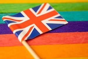 United Kingdom flag on rainbow background symbol of LGBT gay pride month  social movement rainbow flag is a symbol of lesbian, gay, bisexual, transgender, human rights, tolerance and peace. photo