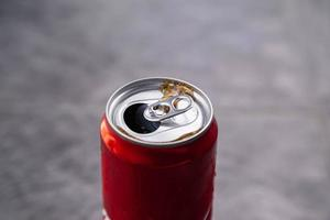 Red drink can and  Black sparkling water photo