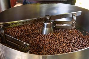 Coffee beans in coffee roasting machines photo
