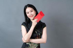 Asian woman wear Chinese traditional dress with red envelope or red packet photo