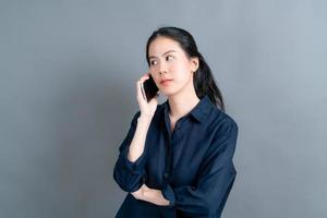 Asian woman using mobile phone talking business photo