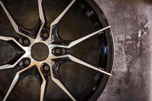 Luxury chrome alloy wheel in close-up as an automotive background.  Close up shot of a new car rim. photo