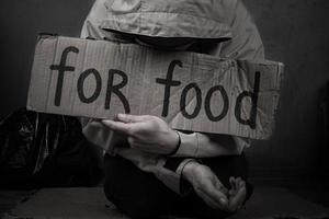 Homeless person asks for help with food photo