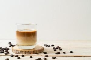 Dirty coffee, cold milk topped with hot espresso coffee shot photo