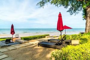 Umbrella and chair  with sea ocean view in hotel resort photo