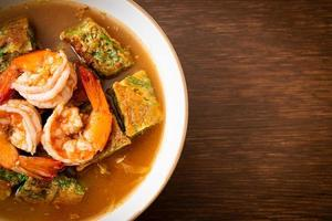 Sour soup made of Tamarind Paste with Shrimps and Vegetable Omelet photo