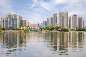 Skyline of Pyongyang by the Taedong River, North Korea photo