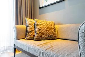 Beautiful pillows decoration on sofa in living room interior photo