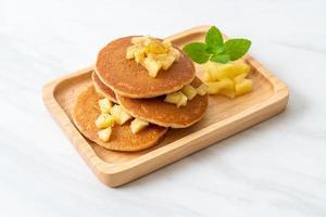 Apple pancake or apple crepe with cinnamon powder photo
