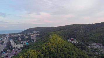 Flying on residential buildings in the mountains Aerial shot video