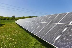 Solar Power Station on the summer flowering Meadow photo