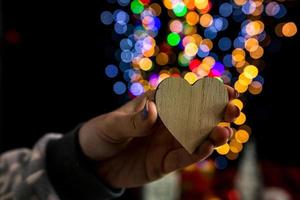 Hand holding Christmas decoration photo