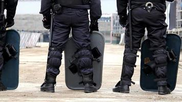 Riot Police guard protest march black live matters video