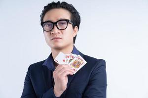 Portrait of Asian businessman holding poker photo