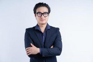 Portrait of Asian businessman standing with arms crossed photo