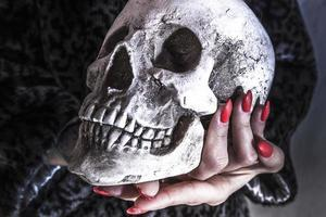 Skull and red nail photo