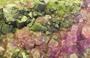 Pink and green colored precious stones photo