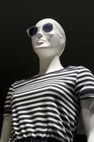 Elegant dummy of a clothing store photo