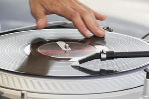 DJ skratching on the turntable photo