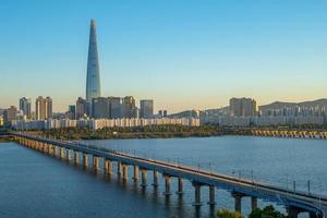 Skyline of Seoul by Han River in South Korea photo