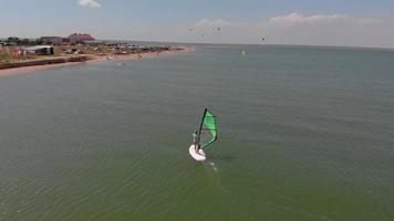 Aerial shot of a woman doing windsurf video