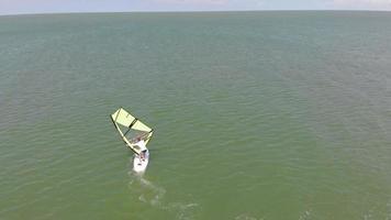 Aerial shot of a man windsurfing video