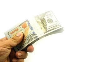 Hand holding bundles 100 American Dollar's Stack Rendering On White photo