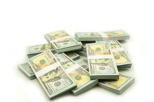 Stack bundles of 100 US dollars banknotes on white background photo