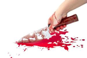 Knife bloody in lady's hand on white background photo