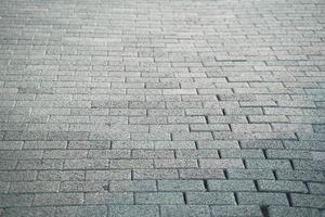 Vista de cerca del material de losas de pavimentación gris pasarela, enfoque selectivo. foto