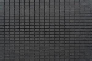 Black tiles wall background. Building exterior decoration. photo